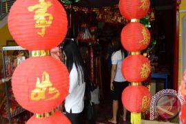 Ini tradisi Tionghoa saat Imlek menjaga keberuntungan