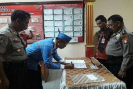 Polres Kotim Tandatangani Kerjasama Pengawasan Dana Desa