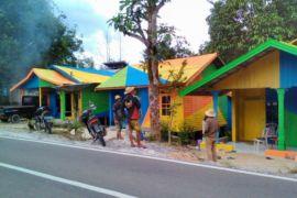 Desa Perbatasan Barito Utara 'Disulap' Jadi Kampung Pelangi