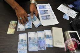 Oknum Polisi Ditangkap Terkait Uang Palsu