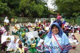 Sekolah IT Ikhtiar pawai sambut Ramadhan