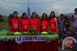 SD GMIM Passo Ikut Lomba Woku Belanga
