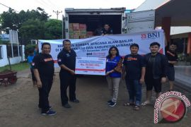 BNI Bantu Korban Bencana Manado-Minahasa