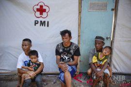 Relawan PMI bagikan kelambu antinyamuk cegah malaria