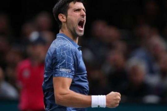 Djokovic Tundukkan Isner di ATP Finals