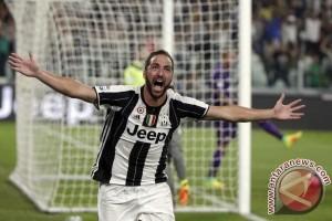 Higuain sandarkan harapan pada AC Milan