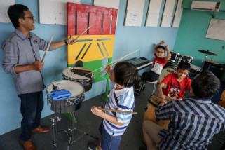 Terapi musik penyandang autis