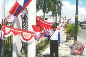 Pedagang Musiman Mulai Jajakan Bendera Merah Putih
