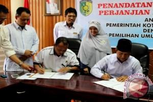 Mantap! KPU-Pemkot Palangka Raya Tandatangani NPHD Pilkada 2018