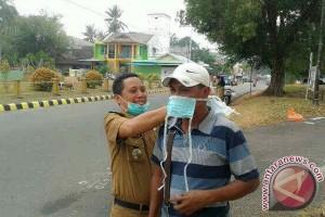 Dinkes Lingga Bagikan Masker kepada Masyarakat