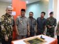 Wakil Ketua I DPRD Karimun Azmi (tengah) menghadiri peresmian Kantor Kas BNI di Teluk Uma, Kecamatan Tebing.
