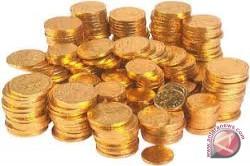 Emas turun mengikuti pergerakan minyak