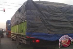 Sampai kapan truk batu bara dilarang ?