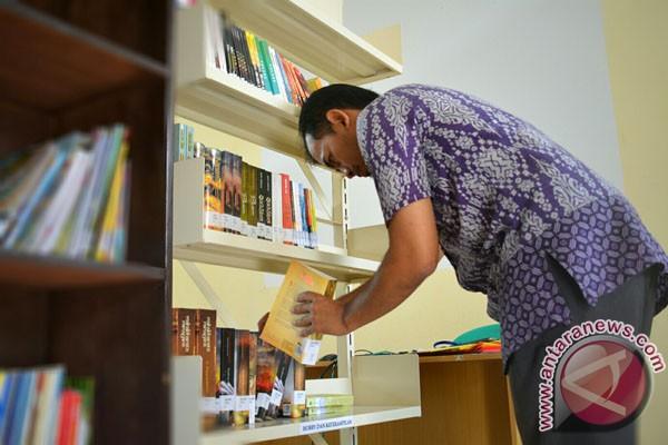 Perpustakaan Desa Muara Gading Mas Dibantu Buku