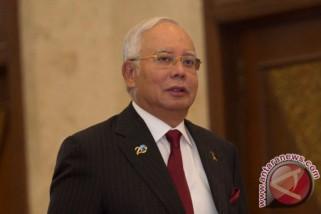 Najib Razak naik pesawat edisi khusus Air Asia