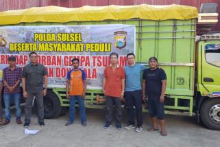 Polisi kawal truk bantuan Polman menuju Palu