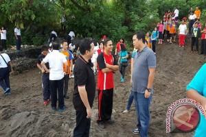 ASN  Manado Bersih-bersih Pantai Dan Muara Sungai