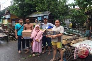 Bulog Salurkan Bantuan dan Bangun Dapur Umum Untuk Korban Banjir Bima