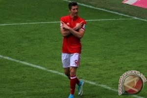 Trigol Lewandowski antar Muenchen cukur Augsburg 6-0