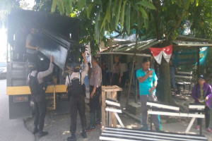 Oknum polisi bersenjata tempur mengancam wartawan Timika