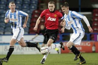 Manchester United melaju ke perempat final Piala FA