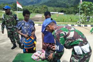 Satgas Yonif 501 Kostrad amankan dua warga PNG
