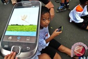 Anak hobi main gadget pandai memilah informasi