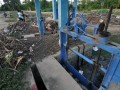 Seorang warga berada di dekat jaringan irigasi yang dipenuhi sampah di kawasan pertanian Kabupaten Sigi, Sulawesi Tengah, Selasa (7/2). Pemerintah menargetkan untuk memperbaiki irigasi yang rusak dan membangun embung guna mendukung produksi pertanian. Embung dan perbaikan irigasi ini ditargetkan bisa mengairi lahan seluas 100 hingga 200 hektare per lokasi embung pada 2017 ini.FOTO ANTARASulteng/Mohamad Hamzah.