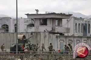 Pasukan Afghanistan bertempur untuk reut kembali pusat distrik