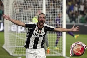 Dua gol Higuain membuat Juventus di ambang ke final Liga Champions