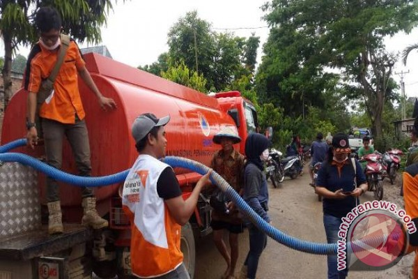 WVI-BPBD  distribusikan air bersih untuk korban banjir Tolitoli