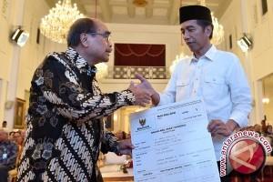 Presiden Jokowi Luncurkan Bayar Zakat di Agen Laku Pandai