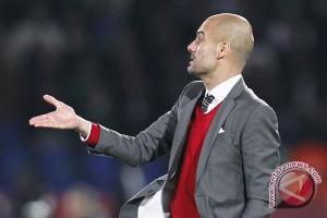 Pep Guardiola bersikeras perburuan gelar masih ketat