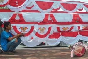 Penjual bendera datangan
