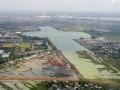Foto udara pengerjaan proyek perluasan danau lintasan dayung di kawasan Jakabaring Sport City (JSC), Palembang, Sumatra Selatan, Sabtu (25/3). Perluasan lintasan dayung Jakabaring dari sebelumnya 1.200 meter menjadi 2.200 meter ini pengerjaannya terus dilakukan guna kelancaran pelaksanaan Asian Games 2018. (Antarasumsel.com/Nova Wahyudi/dol/17)