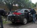 Pewarta mengambil gambar kondisi mobil yang menjadi barang bukti kasus penembakan mobil oleh polisi di Lubuk Linggau, di Mapolda Sumsel, Palembang, Jumat (21/4). Barang bukti tersebut diserahkan kepada Direktorat Khusus Kriminal Umum Polda Sumsel untuk diperiksa sebagai bahan penyelidikan kasus penembakan oleh polisi yang mengakibatkan satu korban tewas dan enam korban luka-luka.(Antarasumsel.com/Feny Selly/Ag/17)