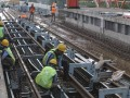 Sejumlah pekerja melakukan pemasangan pemasangan slabtrack dan rel Light Rail Transit (LRT) / kereta ringan di stasiun OPI zona 5 proyek pembangunan LRT Jakabaring, Palembang, SUmatera Selatan, Selasa (4/7). Pemasangan slabtrack dan rel Light Rail Transit (LRT) / kereta ringan sepanjang 23,5 km ini ditargetkan dapat selesai akhir Oktober 2017. (Antarasumsel.com/Nova Wahyudi/dol/17)