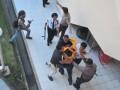 Polisi mengamankan salah satu mahasiswa yang diduga memecahkan kaca pintu di sela aksi demo di Gedung Rektorat Universitas Sriwijaya Kampus Indralaya Kabupaten Ogan Ilir, Sumsel, Kamis (3/8). Insiden di sela Aksi  tuntutan pemangkasan Uang Kuliah Tunggal (UKT) tersebut mengakibatkan salah satu intu kaca gedung rektorat pecah.(Antarasumsel.com/Feny Selly/Ag/17)