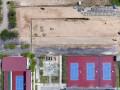 Foto aerial proyek pembangunan delapan lapangan tenis tambahan di Kompleks Jakabaring City (JSC) Palembang, Sumatera Selatan, Kamis (31/8). Untuk memenuhi standar pelaksanaan cabang olahraga tenis Asian Games 2018, Pemerintah Provinisi Sumsel menambah delapan unit lapangan tambahan di Stadion Tenis PT Bukit Asam Jakabaring. (ANTARA Sumsel/Nova Wahyudi/dol/17)