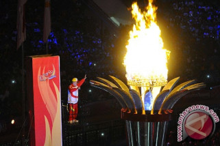 Arak obor Asian Games di sungai musi
