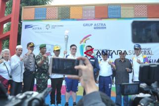 Warga antusias sambut obor Asian Games di Kampung Al Munawar