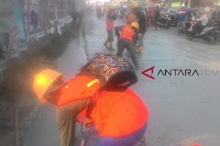 Banjir lumpur di Jalan MP Mangkunegara